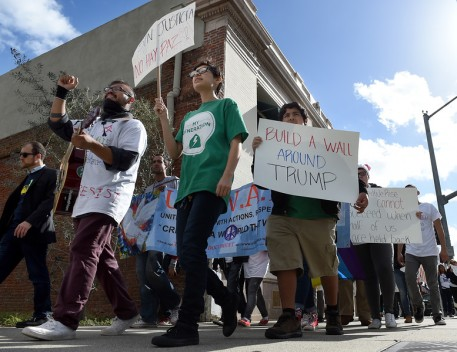 """About 200 protestors march through downtown during a """"United Against the Trump Agenda"""" event in Ontario, CA., Saturday, January 21, 2017. (Staff photo by Jennifer Cappuccio Maher/Inland Valley Daily Bulletin/SCNG)"""