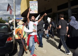 """Fernando Romero, of Upland, with the Pomona Economic Opportunity Center, chants with the crowd as about 200 protestors march through downtown during a """"United Against the Trump Agenda"""" event in Ontario, CA., Saturday, January 21, 2017. (Staff photo by Jennifer Cappuccio Maher/Inland Valley Daily Bulletin/SCNG)"""